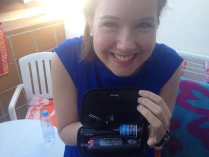 Here I am with a BG meter to prove I have diabetes.